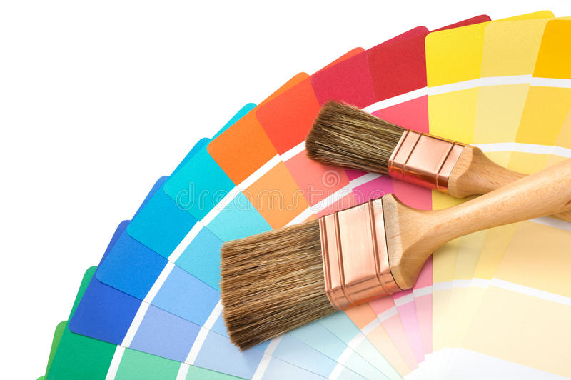 Brushes with a color palette guide. Two brushes on a color palette guide stock images