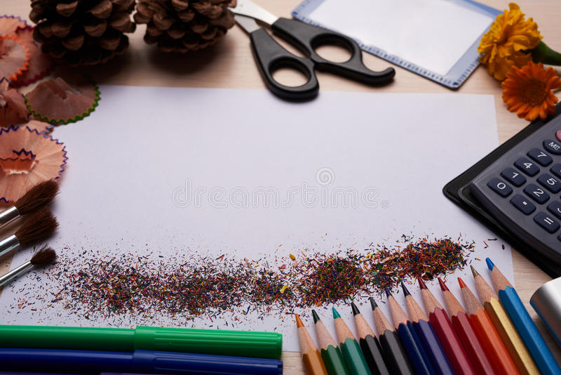 Brushes, colored pencils and other tools. Office and school stationery on the table background stock image