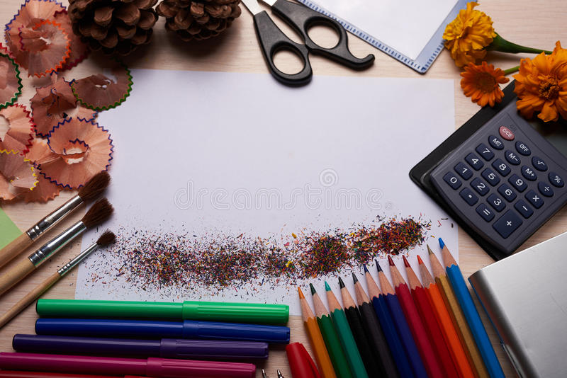 Brushes, colored pencils and other tools. Office and school stationery on the table background royalty free stock photography
