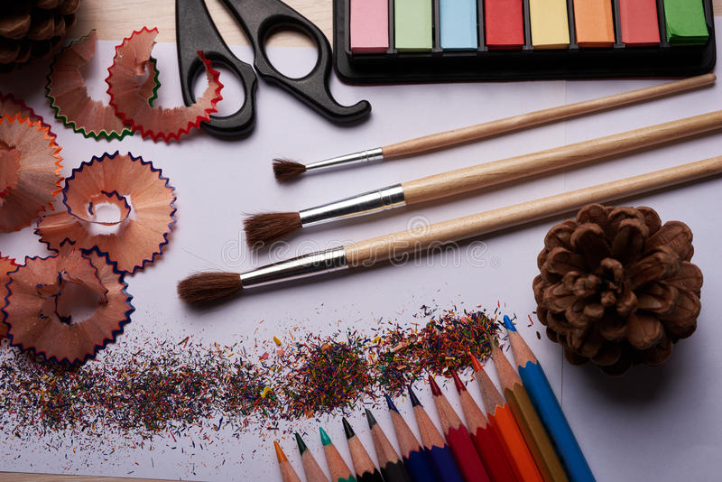 Brushes, colored pencils and other tools. On the table royalty free stock photography