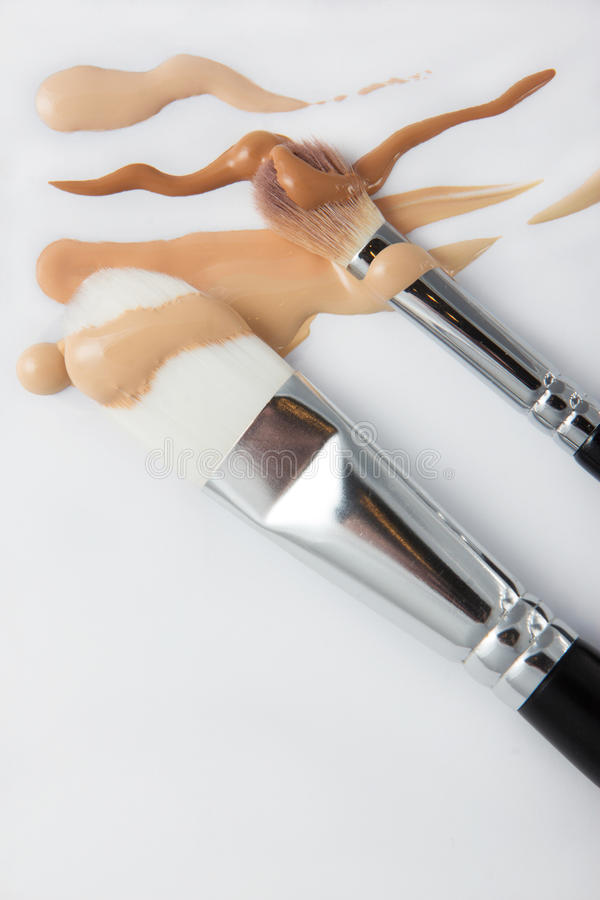 Brushes and liquid foundation stock images