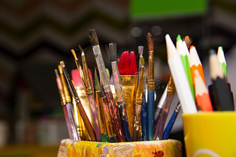 Brushes and pencils for drawing close up royalty free stock photos