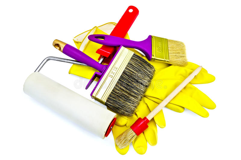 Brushes of various sizes with gloves and roller royalty free stock images