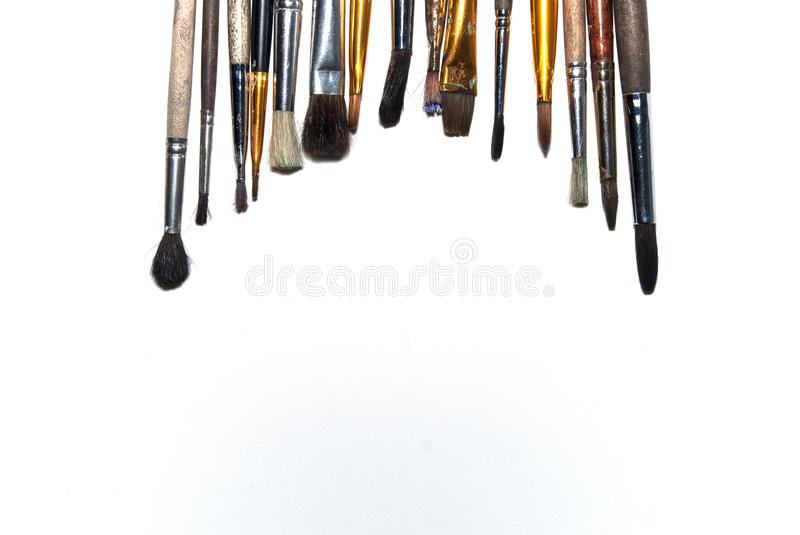 Brushes on a white font. On the table stock photo