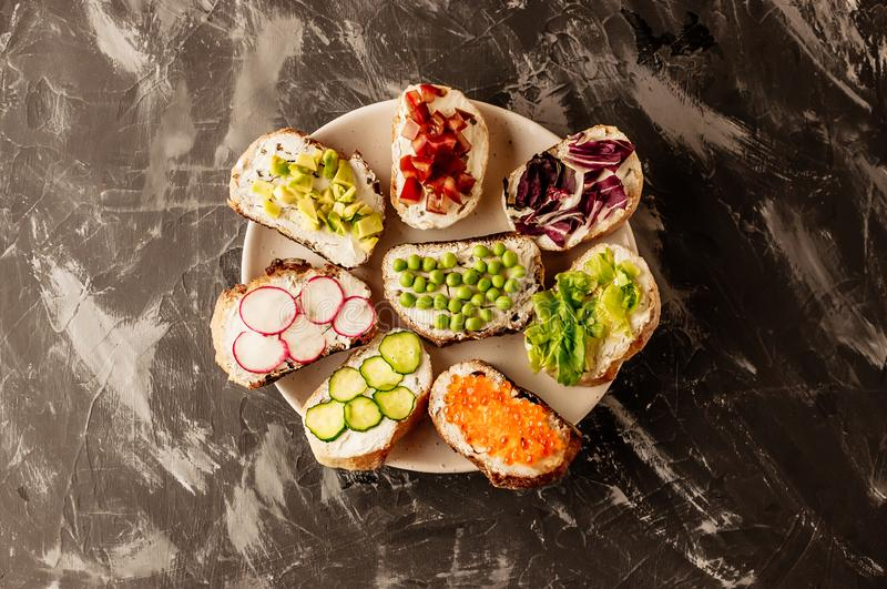 Brushetta or traditional spanish tapas. Appetizers italian antipasti snacks set on wooden board. Top view and flat lay with space stock image