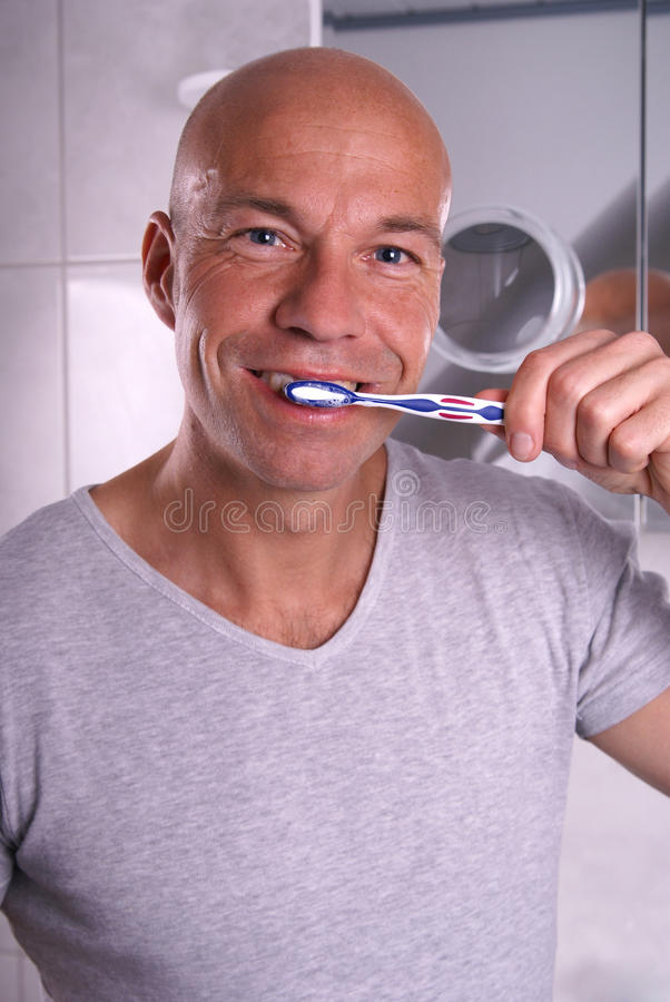 Brushing teeth royalty free stock photo