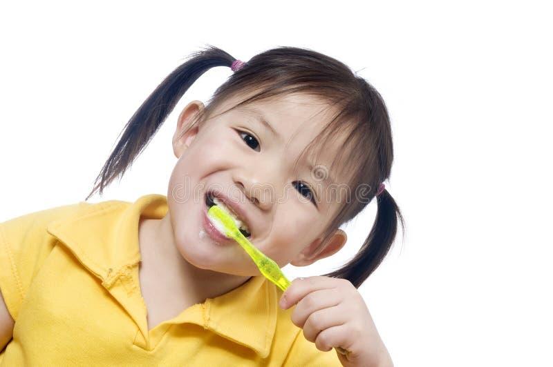 Brushing Teeth. A young girl brushing herteeth. Health and living