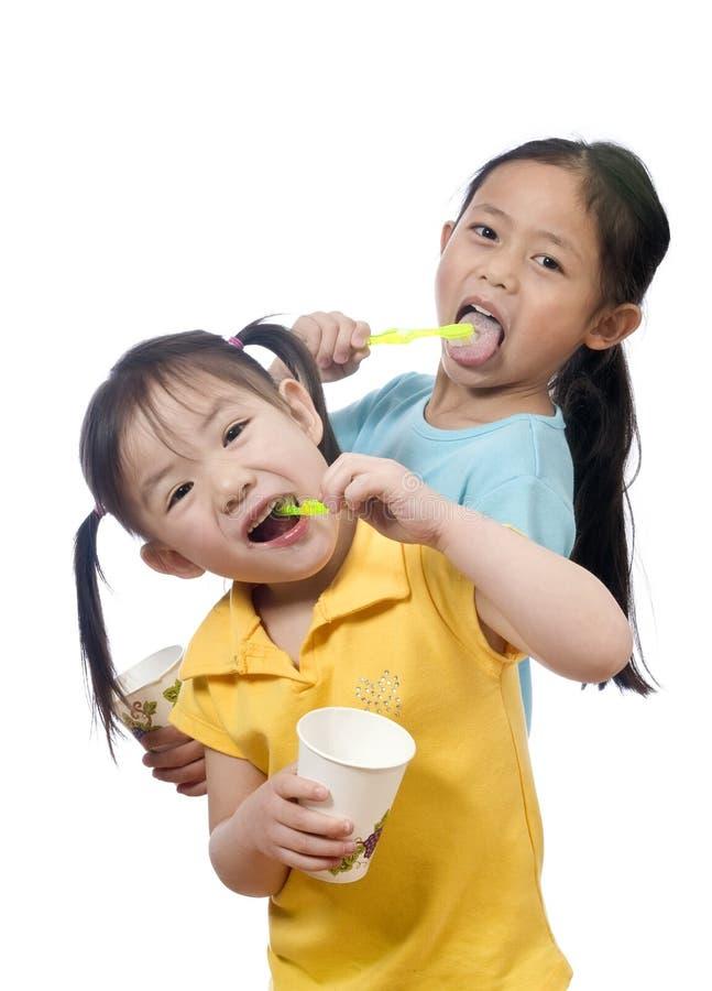 Brushing Teeth. Two sisters brushing thier teeth. Health and living