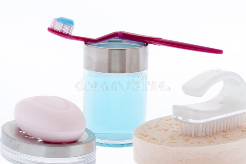 Brushing teeth and personal hygiene. Isolated against white background stock photography