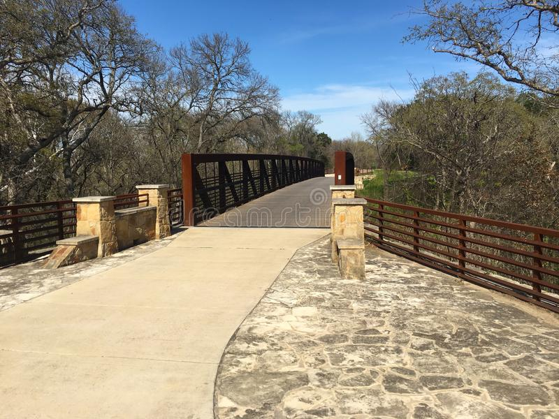Brushy Creek Trail, Round Rock, Texas. Bridge on Brush Creek Trail, Round Rock, Texas. Trail offers a corridor linking neighborhoods, shopping areas, and royalty free stock photos