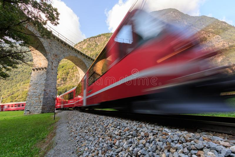Brusio spiral Viaduct with train stock photo