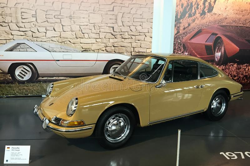 Brussel/Belgium - April, 2018: The exhibit of Auto Museum, Porsche 912 Coupe 1966, dark yellow. Part of standart exposition of Museum. Indoors, copy space royalty free stock images
