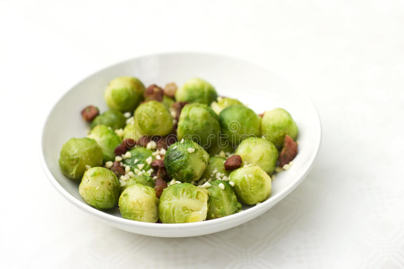 Brussel sprout with bacon. Traditional christmas side dish - brussel sprouts with bacon royalty free stock images