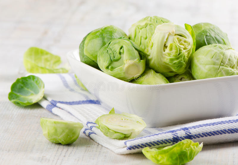 Brussel Sprouts. On wooden table royalty free stock photos