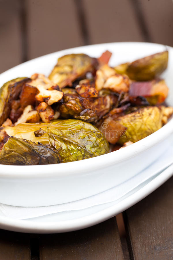 Brussel Sprouts. Dish with walnuts and onions royalty free stock images