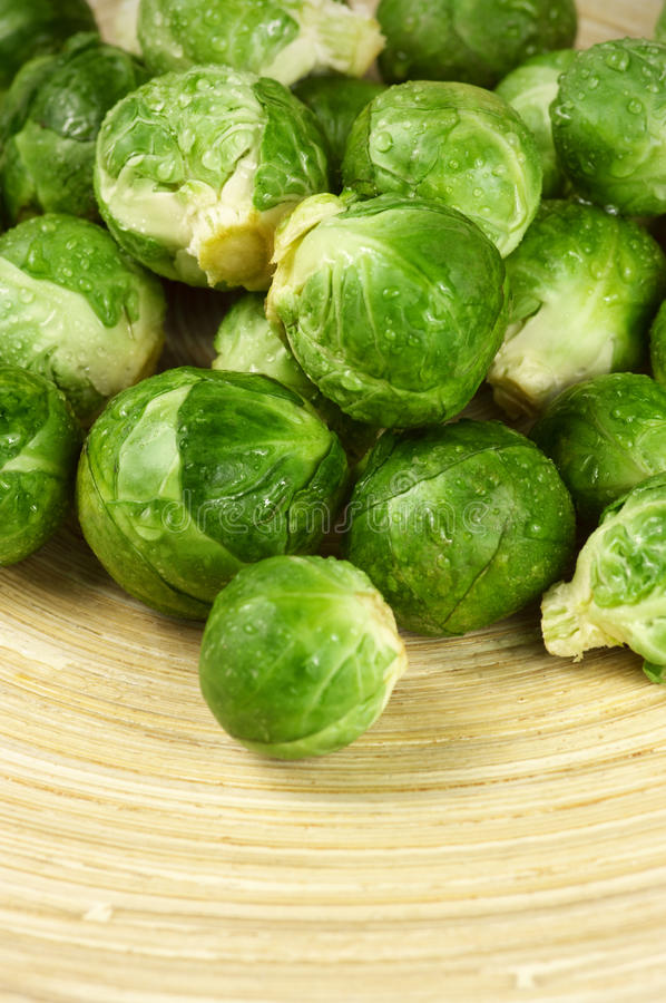 Brussel sprouts. Fresh brussel sprouts on wooden dish royalty free stock photos