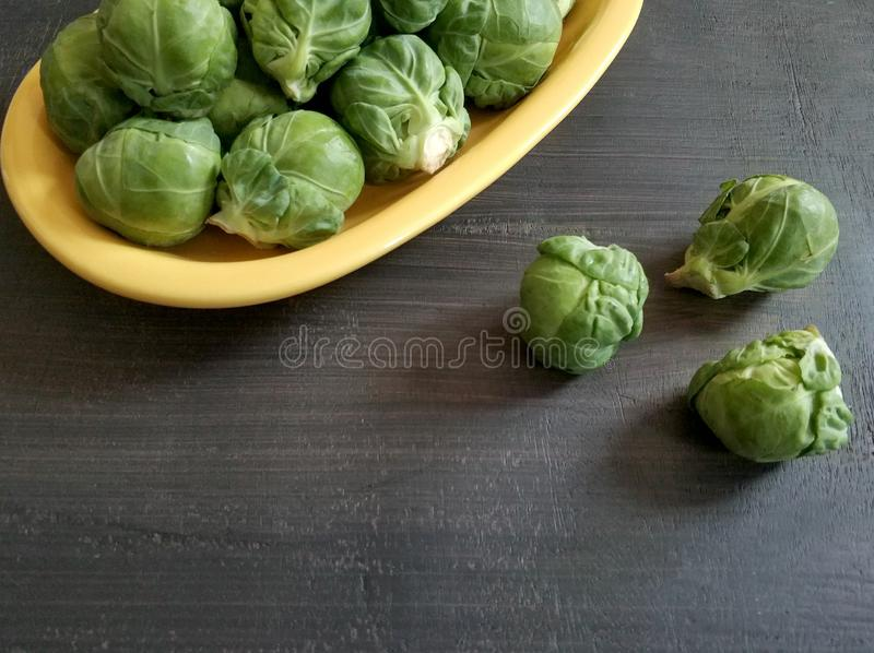 Brussel sprouts in a plate with copy space royalty free stock images