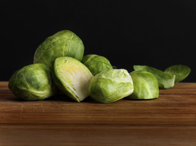 Brussel Sprouts. On worn wooden surface royalty free stock photo