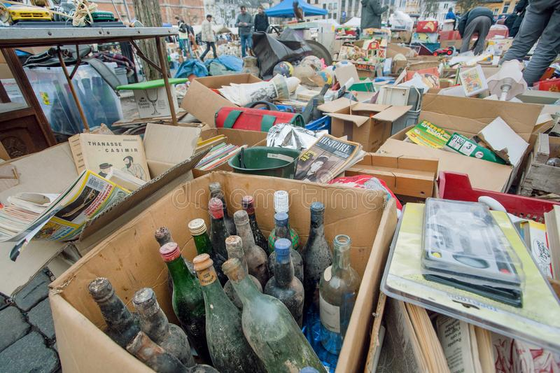 Flea market with old wine bottles, bargains and antique stuff in boxes of vintage decor and retro details royalty free stock photos