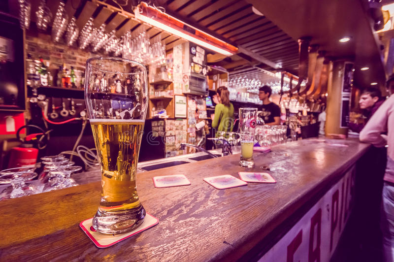 BRUSSELS, BELGIUM - 11 AUGUST, 2015: Glass beer stock photography