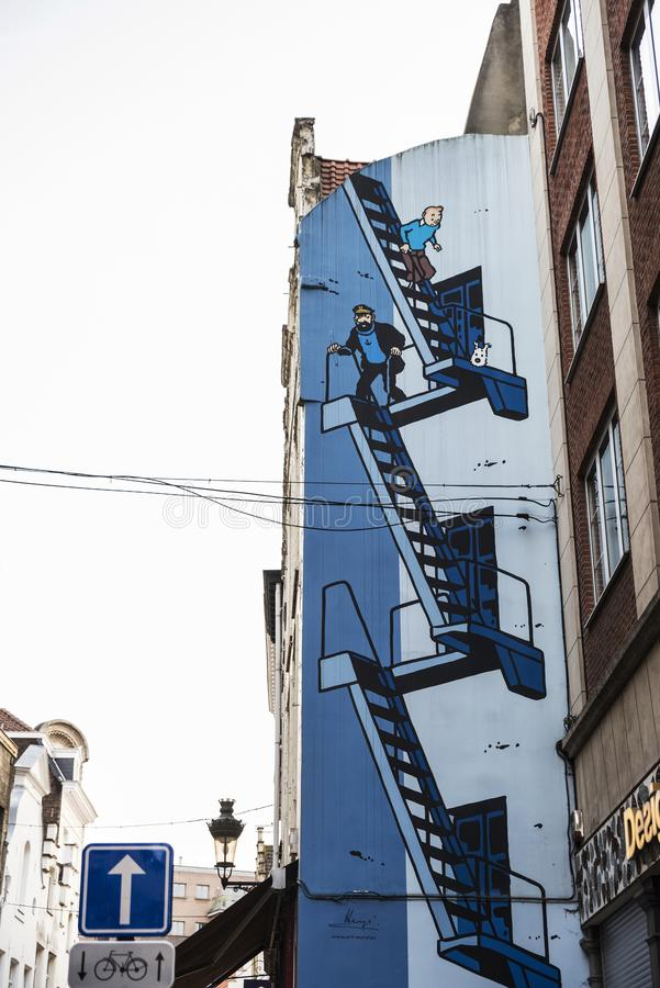 Graffiti with Tintin and Captain Haddock in Brussels, Belgium. Brussels, Belgium - August 26, 2017: Graffiti with Tintin and Captain Haddock on a street in royalty free stock photos