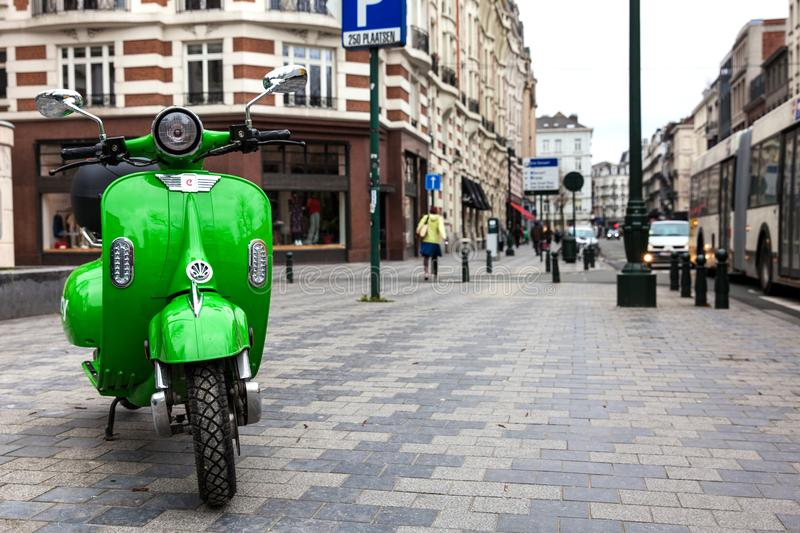 Eco friendly electric sharing scooter parked at the street in Brussels royalty free stock photo