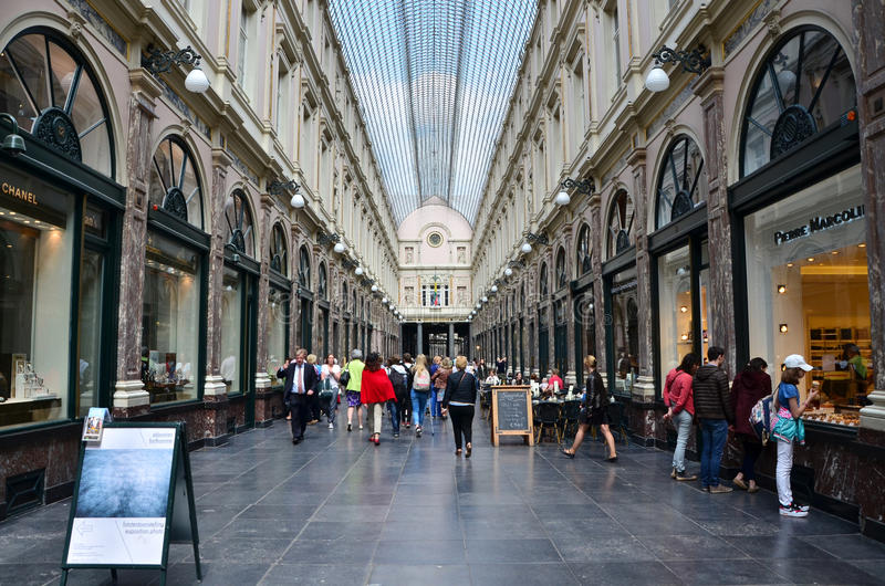 Brussels, Belgium - May 12, 2015: Tourists shopping at The Galeries Royales Saint-Hubert in Brussels. Belgium. This place is a glazed shopping arcade in royalty free stock photos