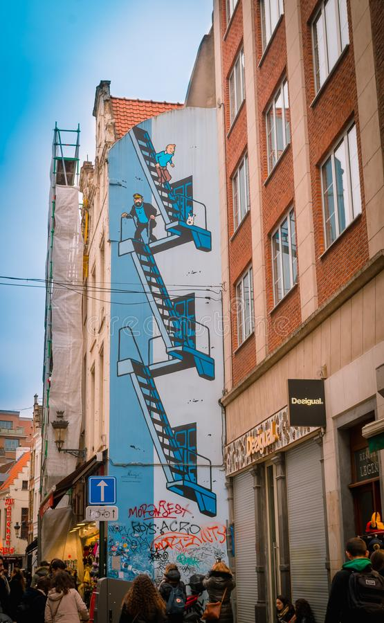 Brussels, Belgium, May, 31, 2018: Wall painting of Tintin and Captain Haddock in its country of creation. In a building in the city of Brussels in Belgium stock photography