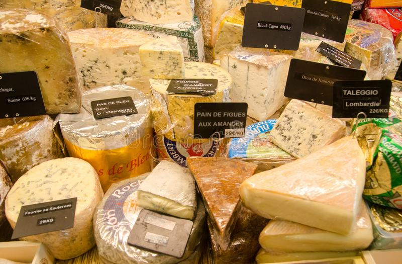 Large assortment of cheeses for sale at local street market stock image