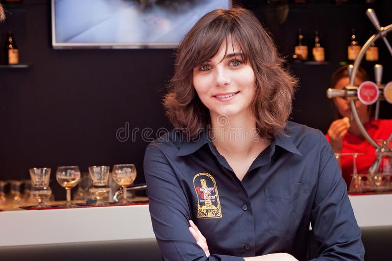 BRUSSELS, BELGIUM - SEPTEMBER 07, 2014: Unknown young woman in a branded shirt of the Bourgogne des Flandres brewery. Unknown young woman in a branded shirt of royalty free stock photo