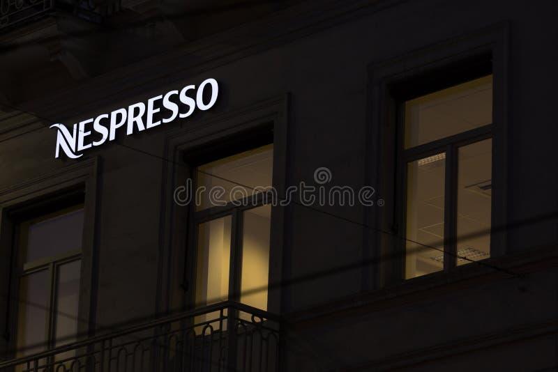 Brussels, brussels/belgium - 13 12 18: nespresso sign in brussels belgium in the evening. Brussels, brussels/belgium - 13 12 18: an nespresso sign in brussels royalty free stock photo