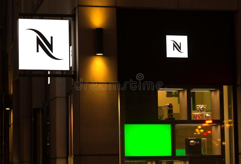 Brussels, brussels/belgium - 13 12 18: nespresso sign in brussels belgium in the evening. Brussels, brussels/belgium - 13 12 18: an nespresso sign in brussels royalty free stock photography