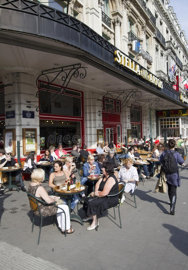 Brussels Cafe. Brussels, Belgium - May 5, 2011: People sit on an outside cafe terrace on a street corner in Brussels, Belgium on May 5, 2011 stock photo