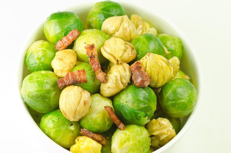 Brussels, chestnuts and crispy lardons stock image