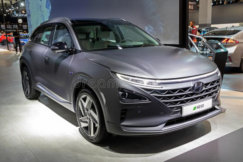 BRUSSELS - JAN 9, 2020: New Hyundai Nexo hydrogen fuel cell powered crossover SUV car model showcased at the Brussels Autosalon. 2020 Motor Show grey gray royalty free stock photo