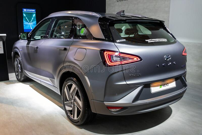 BRUSSELS - JAN 9, 2020: New Hyundai Nexo hydrogen fuel cell powered crossover SUV car model showcased at the Brussels Autosalon. 2020 Motor Show grey gray royalty free stock photography