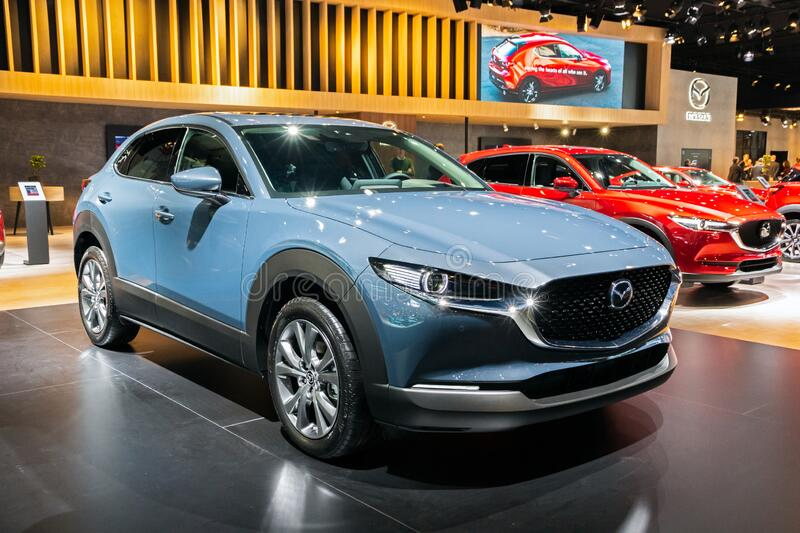 BRUSSELS - JAN 9, 2020: New Mazda MX-30 car model showcased at the Brussels Autosalon 2020 Motor Show. Event modern blue vehicle exhibition automobile stock photos