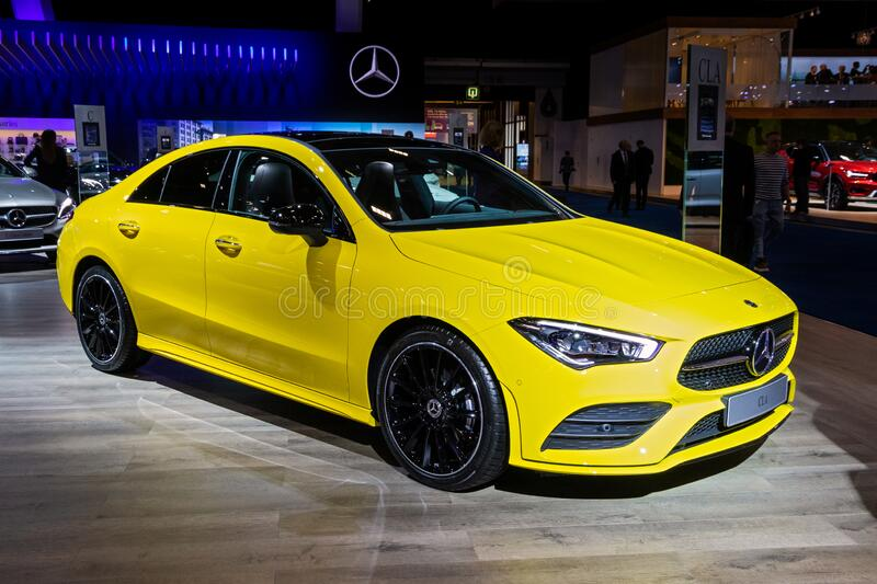 BRUSSELS - JAN 9, 2020: New Mercedes CLA Shooting Brake car model presented at the Brussels Autosalon 2020 Motor Show. Green transport modern yellow royalty free stock image