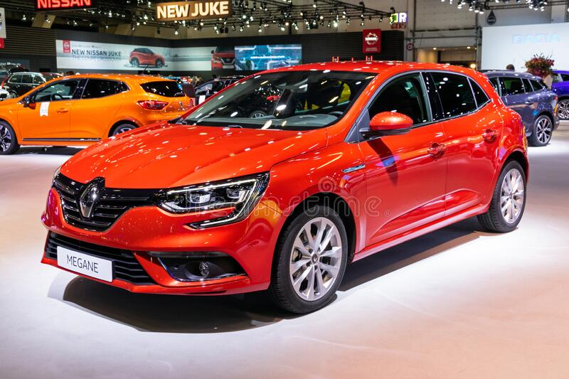 BRUSSELS - JAN 9, 2020: New Renault Megane car model showcased at the Brussels Autosalon 2020 Motor Show. Red modern automobile automotive type newest autoshow royalty free stock photo