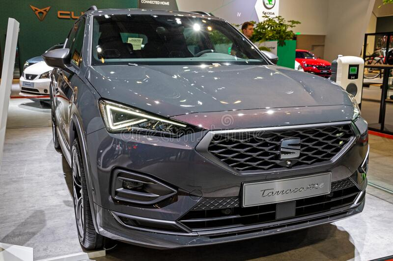 BRUSSELS - JAN 9, 2020: New SEAT Tarraco FR PHEV performance hybrid car model showcased at the Brussels Autosalon 2020 Motor Show. Grey gray modern automobile royalty free stock photography
