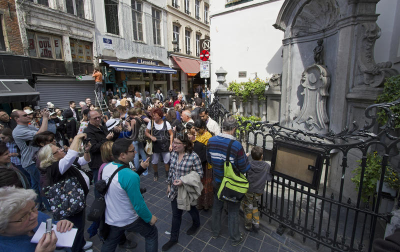 Brussels Manneken Pis. Brussels, Belgium - May 5, 2011: Tourists at the Manneken Pis fountain in Brussels, Belgium on on May 5, 2001 royalty free stock photos