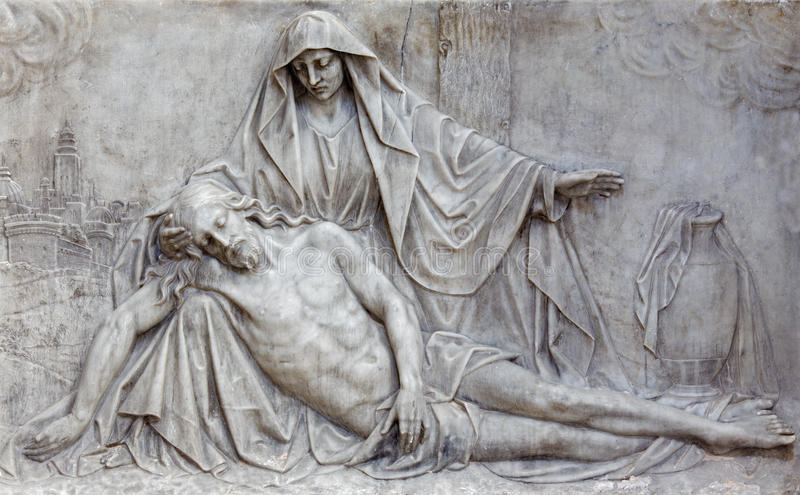 Brussels - The marble relief of Pieta in church Notre Dame aux Riches Claires. BRUSSELS, BELGIUM - JUNE 15, 2014: The marble relief of Pieta in church Notre Dame royalty free stock photography