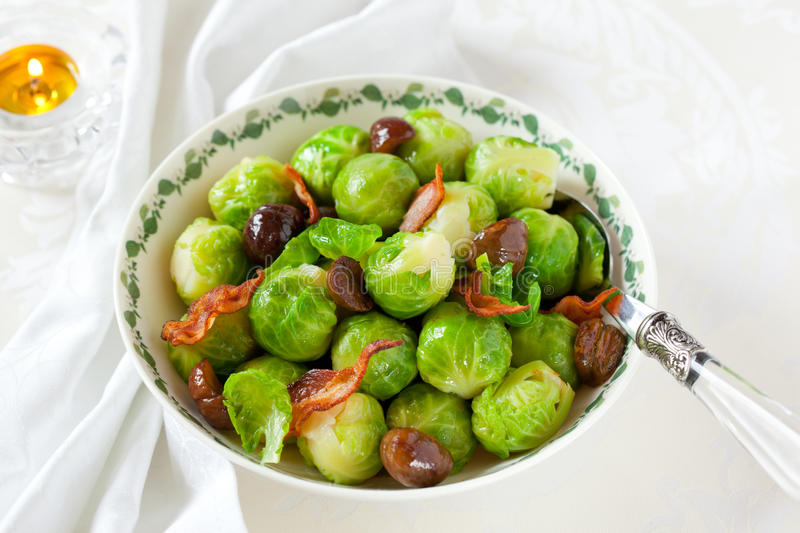 Brussels sprouts with bacon and chestnuts royalty free stock photos