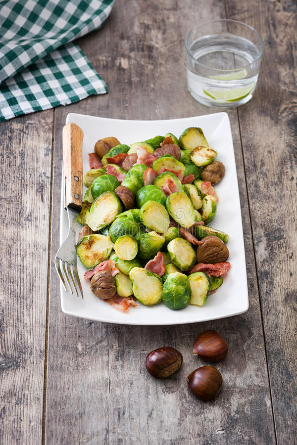 Brussels sprouts with chestnuts and bacon stock photos