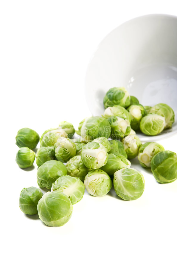 Brussels sprouts and plate on white background stock photos