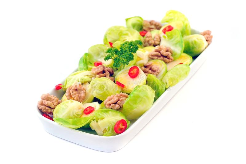 Brussels sprouts salad. Brussels sprouts with walnut and chili pepper, salad stock photos