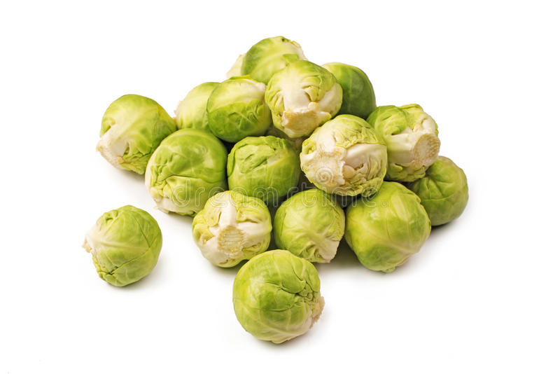 Brussels sprouts on a white. A pile of Brussels sprouts on a white background stock photography