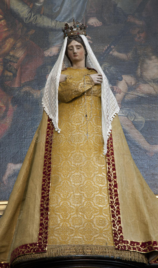Brussels - Virgin Mary statue in the needlework garments. From side altar at st. Nicholas church on June 21, 2012 in Brussels stock image