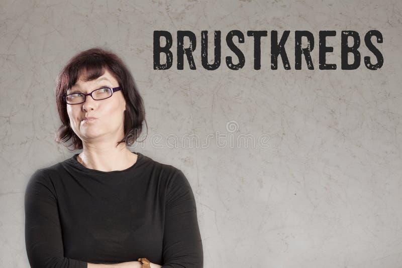 Brustkrebs, German text for Breast Cancer woman writing on grunge background. Brustkrebs, German text for Breast Cancer, , sceptical woman looking at text grunge stock images