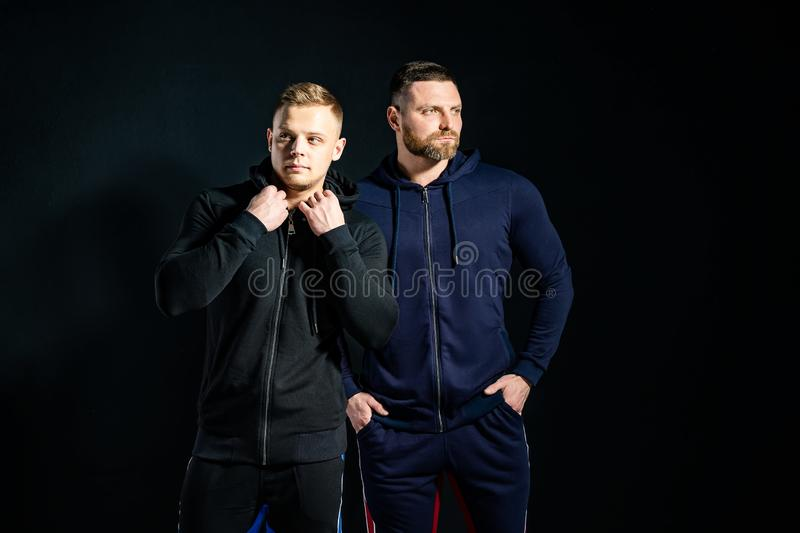 Trendy serious men in stylish sport suits royalty free stock photo